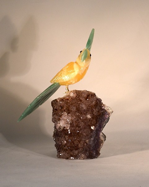small hand carved yellow cockatoo bird