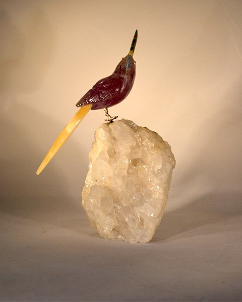 Maroon Crystal Bird Carving with yellow tail feather