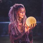 Young lady holding a healing ball that represents Healing Properties of Gemstones